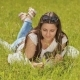 Beautiful Brunette with Long Hair Lying on Green Grass with a Smile and Enjoy Nature. - VideoHive Item for Sale