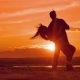 Couple Dancing a Slow Dance in Sunset Sun Silhouettes - VideoHive Item for Sale