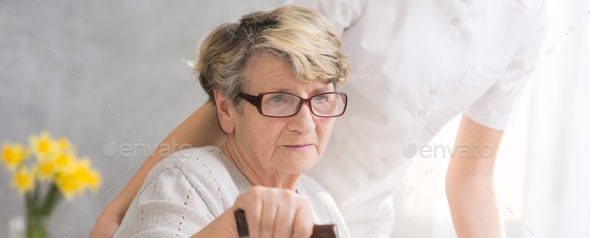 Elderly woman with hand on cane - Stock Photo - Images