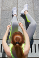 Woman tying shoelaces before running in a sunny day - PhotoDune Item for Sale