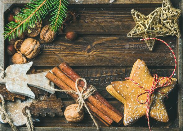 Sweet cookies, wooden angels, decorative golden stars, nuts, cinnamon sticks - Stock Photo - Images