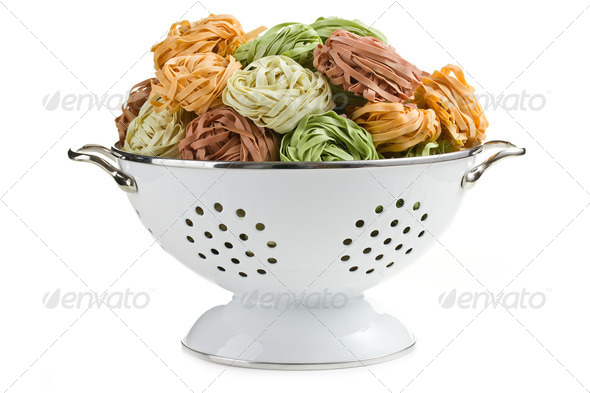 pasta tagliatelle in colander - Stock Photo - Images