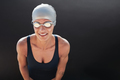 Young beautiful sportswoman in swimsuit with swimming goggles