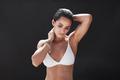 Muscular young female model in swimwear
