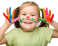 Portrait of a cute girl with painted hands - PhotoDune Item for Sale