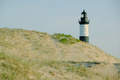 Big Sable Point Lighthouse in dunes, built in 1867