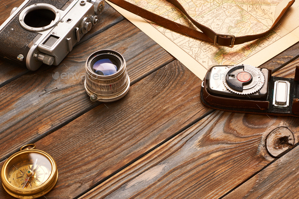 Vintage camera and lens on antique XIX century map - Stock Photo - Images