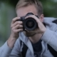On The Lawn Of A Young Man With A Professional Digital Camera - VideoHive Item for Sale