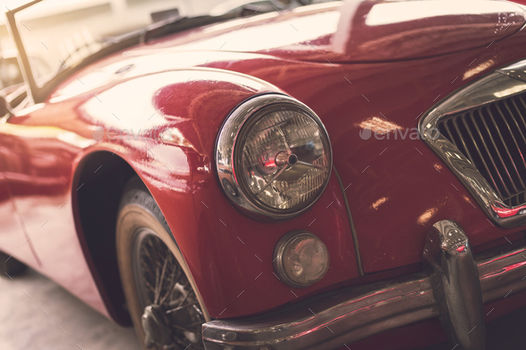 Close up headlight of red Retro classic car - Stock Photo - Images