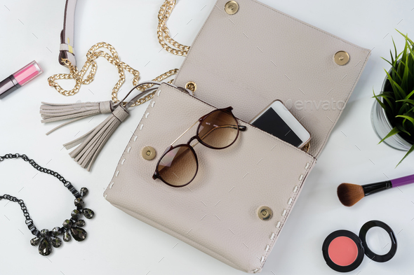 Fashion woman handbag with cellphone, makeup and accessories - Stock Photo - Images