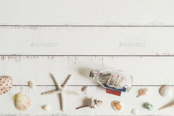 sail boat toy model and shell - Stock Photo - Images