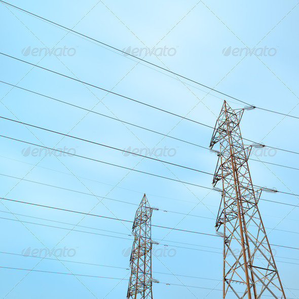 Two transmission towers, also known as electricity pylons.  - Stock Photo - Images
