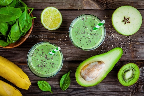 healthy green smoothie with banana, spinach, avocado and chia seeds in glass jars - Stock Photo - Images