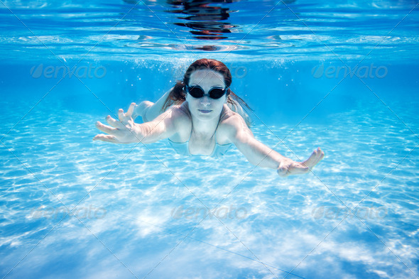 Woman swimming underwater - Stock Photo - Images