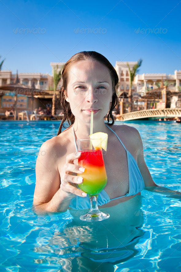 Woman drinking a fruit cocktail - Stock Photo - Images