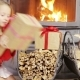 Adorable Little Girl Opening Christmas Gifts Near Fireplace - VideoHive Item for Sale