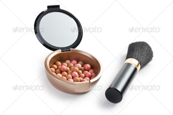 bronzing pearls and makeup brush - Stock Photo - Images