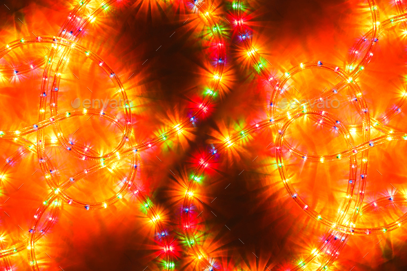 Colored light christmas garland illumination background, unfocused. - Stock Photo - Images