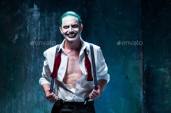 Bloody Halloween theme: crazy joker face - Stock Photo - Images
