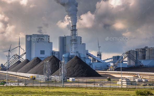 Heavy industrial coal powered electricity plant - Stock Photo - Images