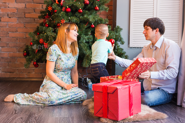 Happy Family Decorating Christmas Tree Together Father Mother And Son Cute Child Kid
