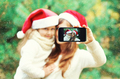 Christmas mother and child taking picture self portrait on smart