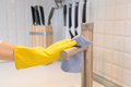 Closeup of female hand in gloves cleaning the kitchen tap - PhotoDune Item for Sale