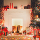 Download Christmas room interior design, decorated tree in garland lights from PhotoDune