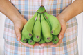 Bunch of green organic bananas in hands - PhotoDune Item for Sale