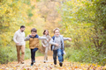 Beautiful young family on a walk in autumn forest. - PhotoDune Item for Sale
