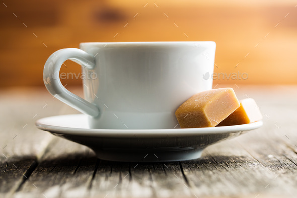 Coffee cup and caramel candies. - Stock Photo - Images