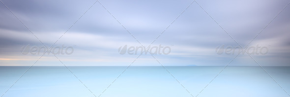 Long exposure photography panorama 3:1 with soft sea and cloudy sky - Stock Photo - Images