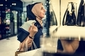 Young Woman Shopping Consumer Concept - PhotoDune Item for Sale