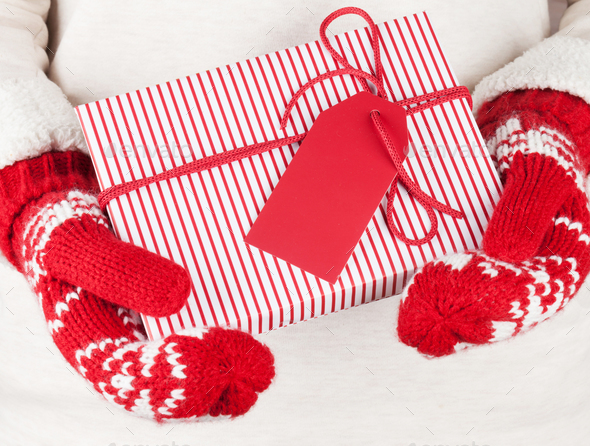 Female hands holding christmas gift - Stock Photo - Images