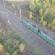 Train Rides Through an Autumn Forest on the Horizon You Can See the City. - VideoHive Item for Sale