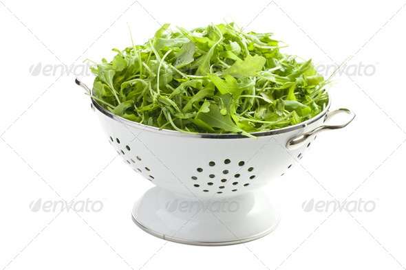 arugula leaves in white colander - Stock Photo - Images