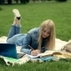 Female Student Studying on Campus Lawn. - VideoHive Item for Sale