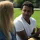 Interacial Couple of Students Discussing Outdoors - VideoHive Item for Sale