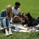 Threesome Students Studying on Campus Lawn. - VideoHive Item for Sale