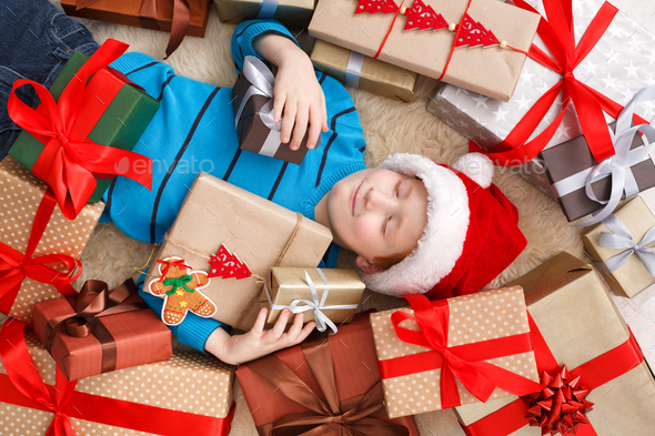 Happy child with Christmas present boxes and gifts, top view - Stock Photo - Images