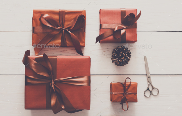 Top view of christmas present boxes on white wood background - Stock Photo - Images