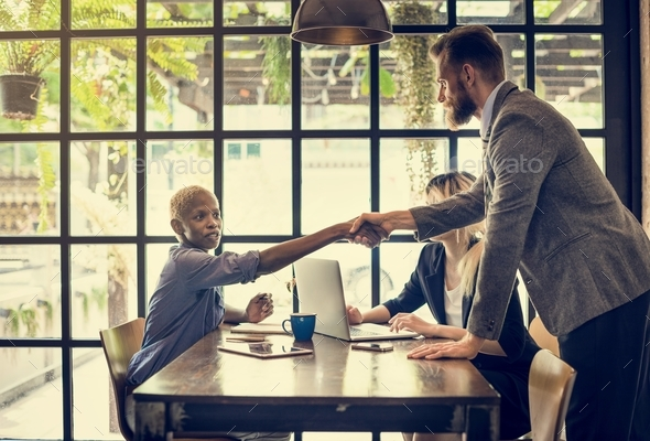 Multiethnic Business Partners Handshake Deal Team Concept - Stock Photo - Images