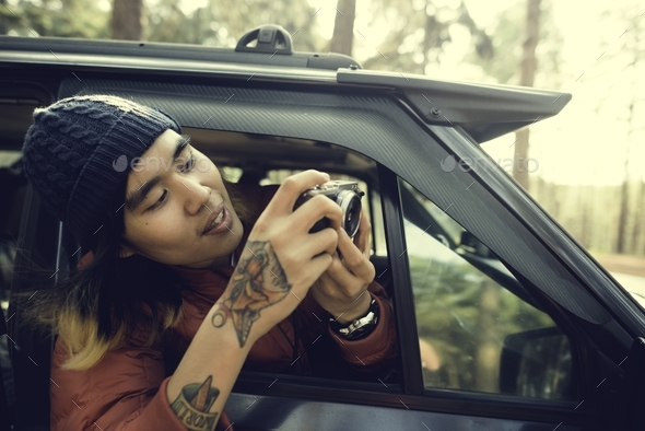 Asian Photographer Taking Pictures Outdoors Concept - Stock Photo - Images