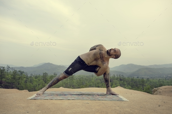 Man Doing Yoga Exercise Concept - Stock Photo - Images