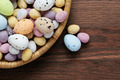 Speckled chocolate easter eggs in a basket - PhotoDune Item for Sale