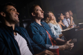 Group of people in theater watching movie