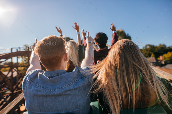Young people on a thrilling roller coaster ride - Stock Photo - Images