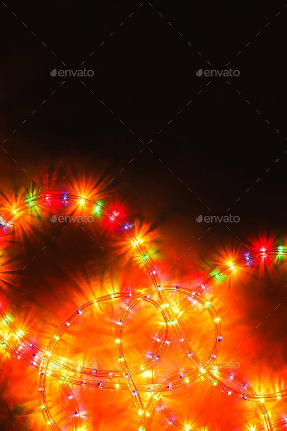 colored light christmas garland illumination background on black unfocused stock photo images