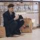 Disappointed Young Man Sitting on the Floor in Mall Without Money After Black Friday Sales - VideoHive Item for Sale