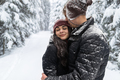 Young Romantic Couple In Snow Forest Outdoor Man And Woman Embrace - PhotoDune Item for Sale